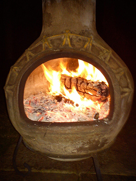 A fire burning in a chiminea.