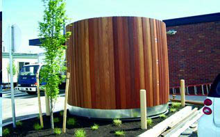A large outdoor cistern with vertical wood outer layer.