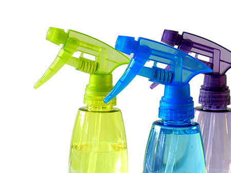 Three different colored cleaning sprayer bottle.