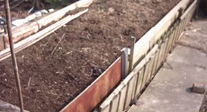 A home made raised garden bed structure before planting.